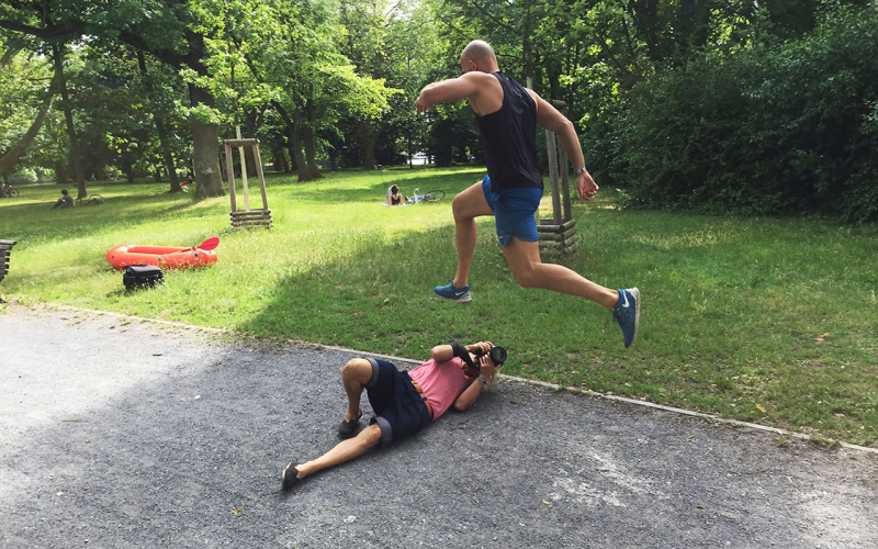 Jessica Zumpfe Photography lying on the ground in Berlin, shooting a personal trainer jumping overr her.