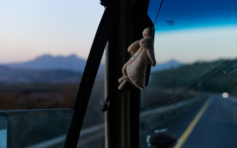 Evening shot of an angel flying at the window of Jessica Zumpfe's camper van on her way back home. Table Mountain in the Background.