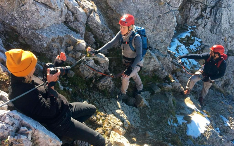Professional shooting for an outdoor client. Jessica Zumpfe directs the sports models on the ferrata in the Karwendel Mountains.