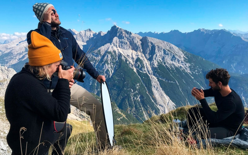Professional Cape Town photographer shooting in the alps. The image shows her with her assistant and sports model ontop of the Karwendel Gebirge.