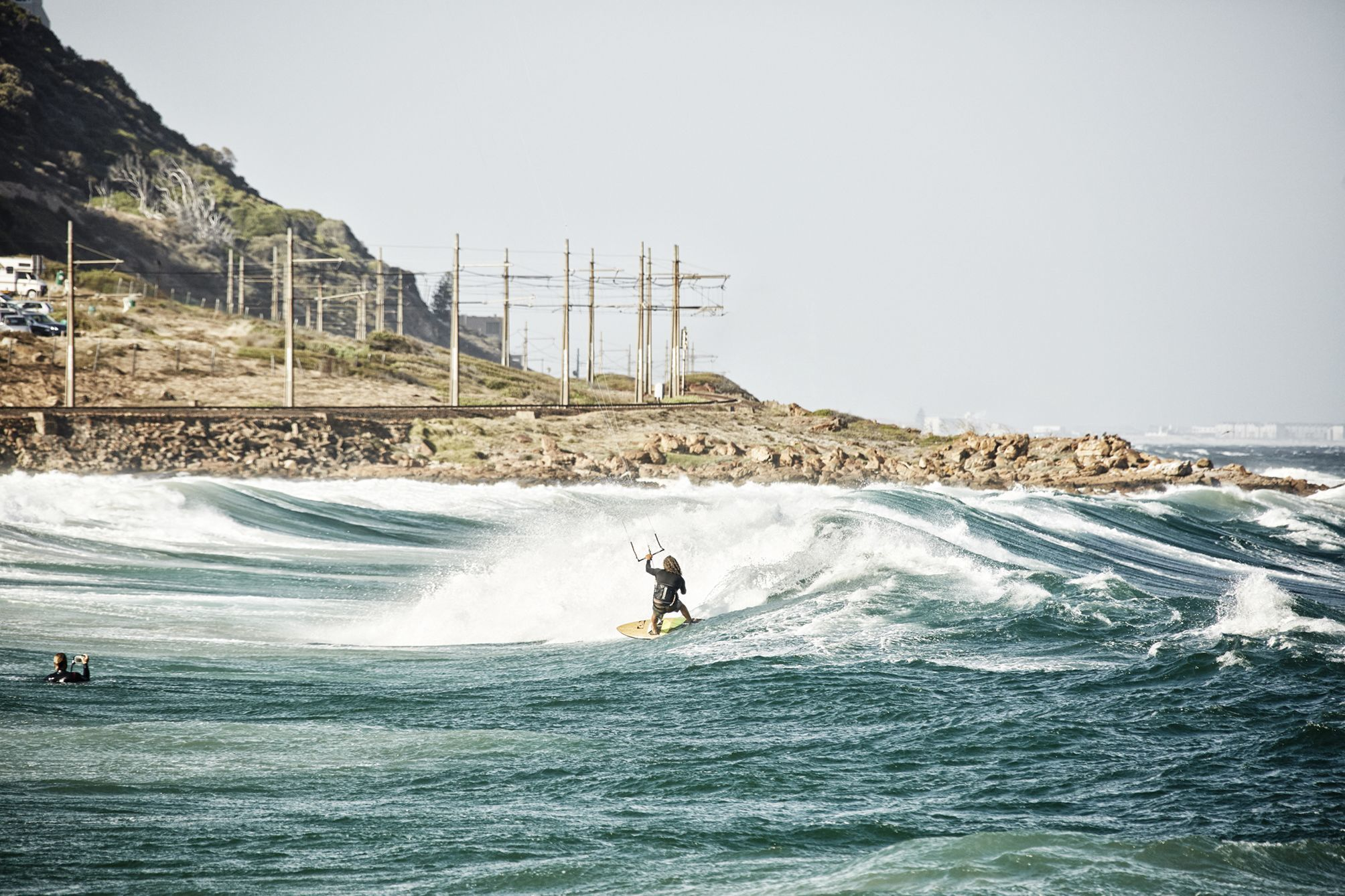 Kiter riding a wave at glencairn beach in cape town
