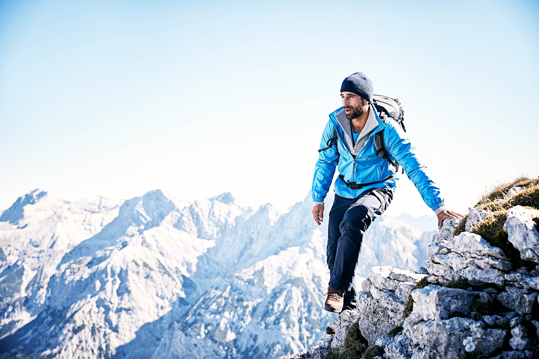 Sports pic showing a man hiking in the alps