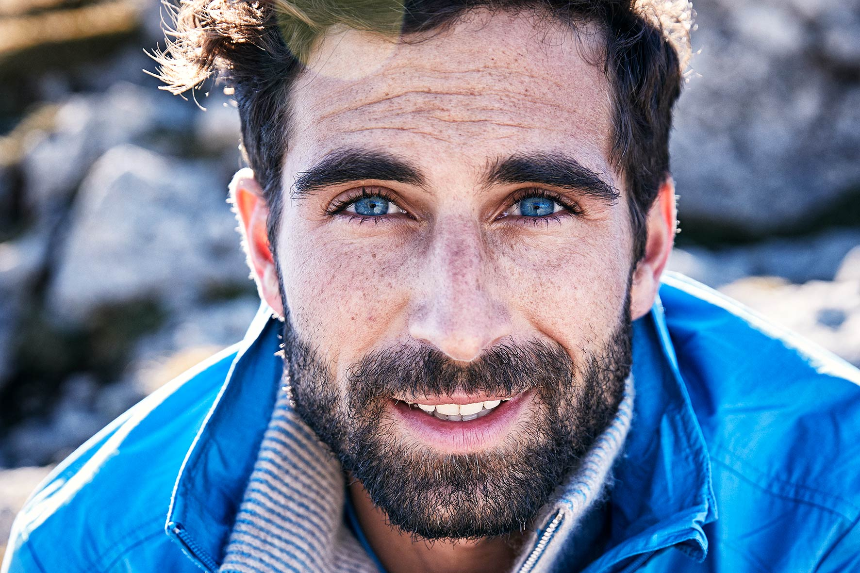 Mountain climber looks into the camera