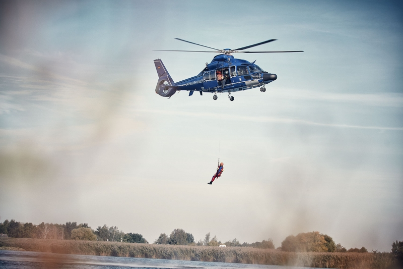 Rescue Helicopter lowering a lifeguard into the water
