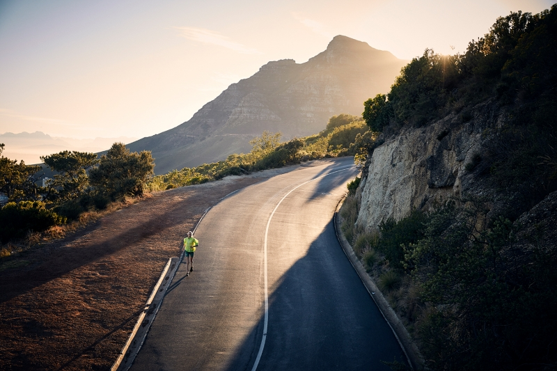 Athlete road running early in the morning along Table Mountain