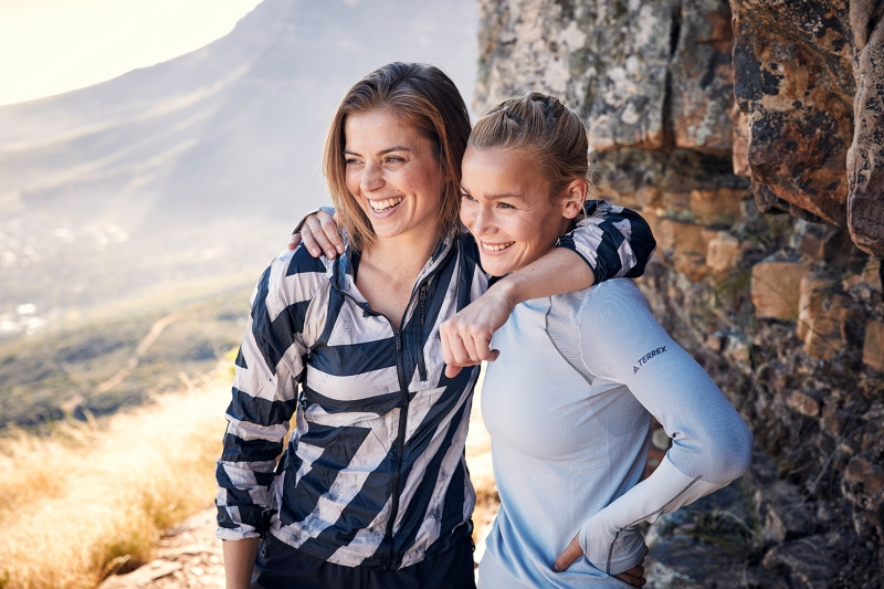 Two friends happy on top of Table Mountain