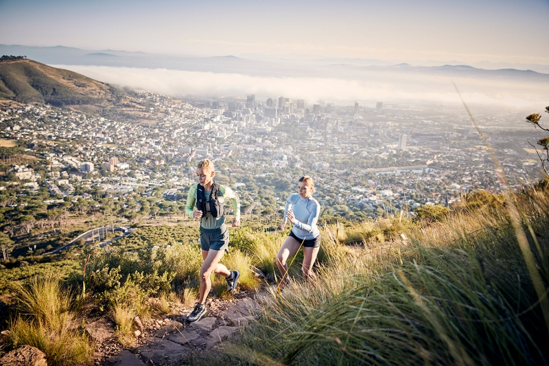 Two young athletes trailrunning in Cape Town