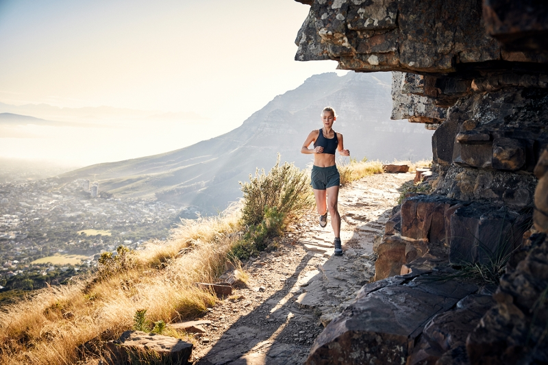 Athlete trail running on Table Mountain