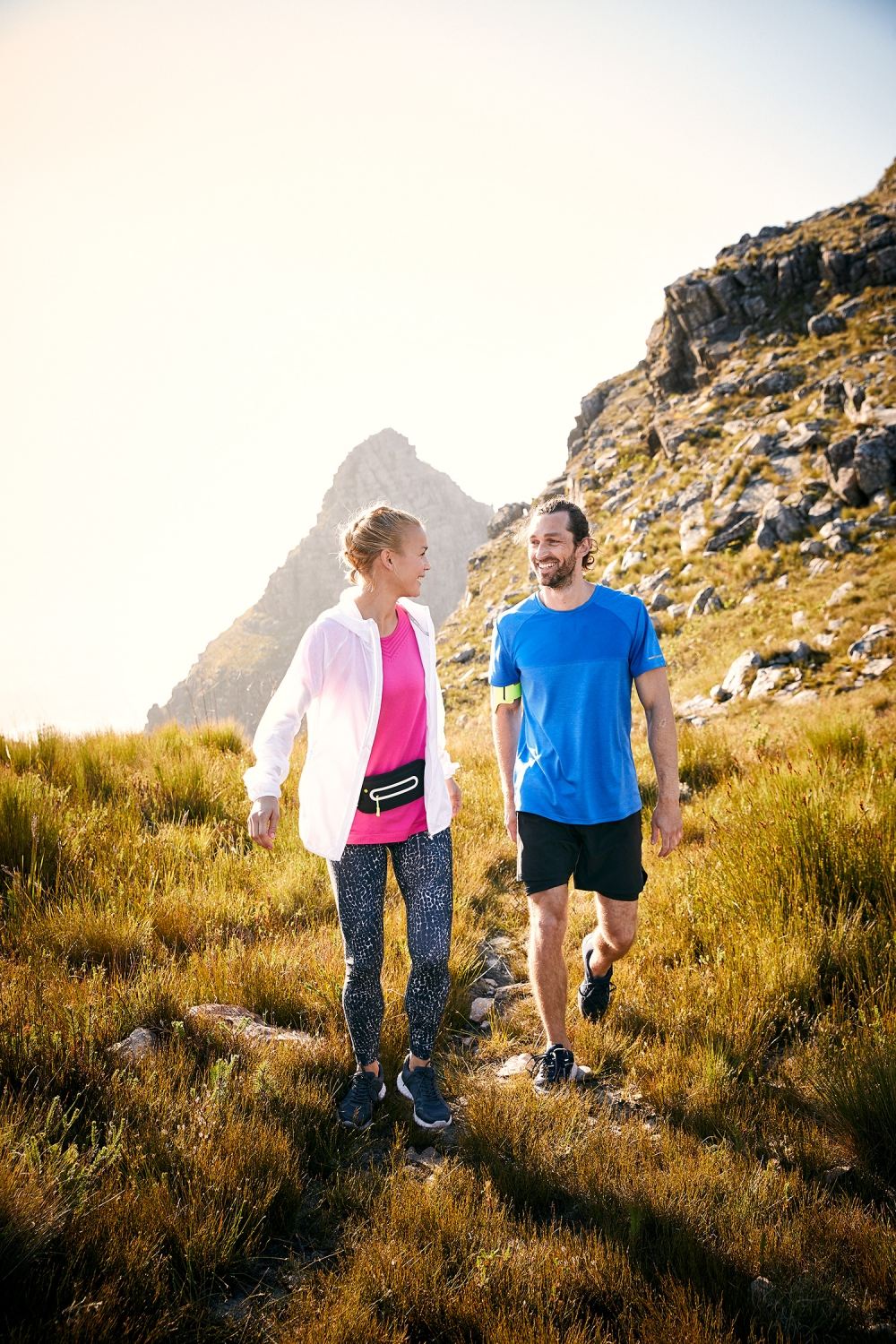 Young couple hiking at sunset on top of the du Tooitskloof mountain range