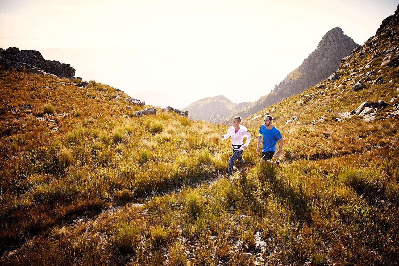 A couple trailrunning at sunset on the du Tooitskloof mountain range.