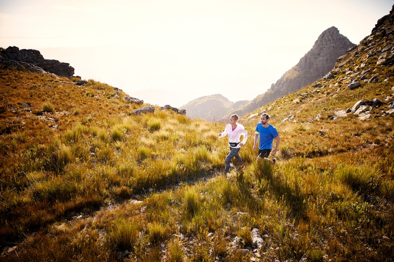 A couple trailrunning at sunset on the du Tooitskloof mountain range.