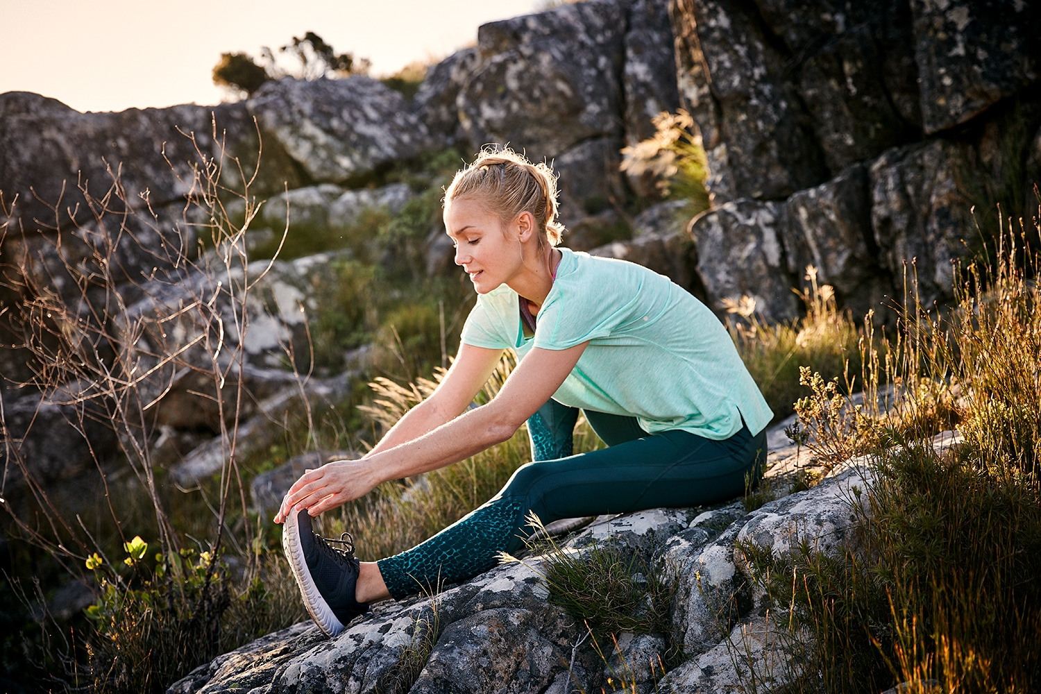 Young Model stretching on the mountains inland of Cape Town