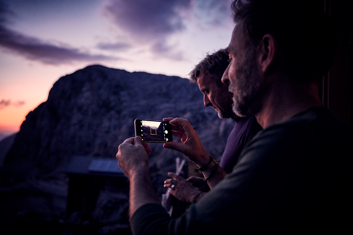 WALDEN Magazin Founders Harald Willenbrock and Markus Wolff enjoying the sunset ontop of the mountain on their first mountaineering tour