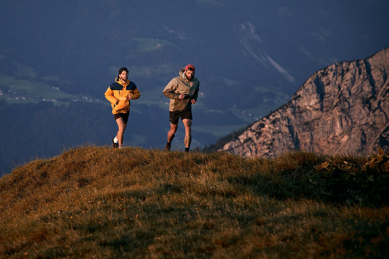 Two men trailrunning in the sunrise on Rofanspitze in Austria