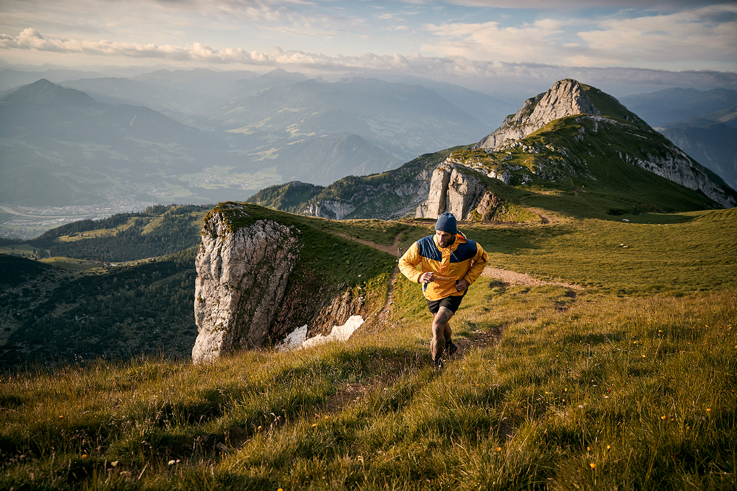 Man trailrunning at the top of the mountain in Rofan