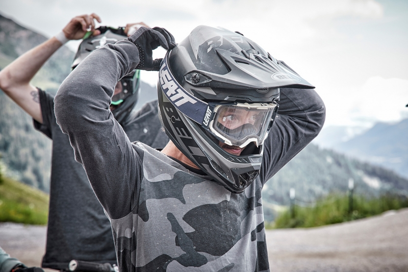 Portrait of a Mountainbiker fixing his goggles