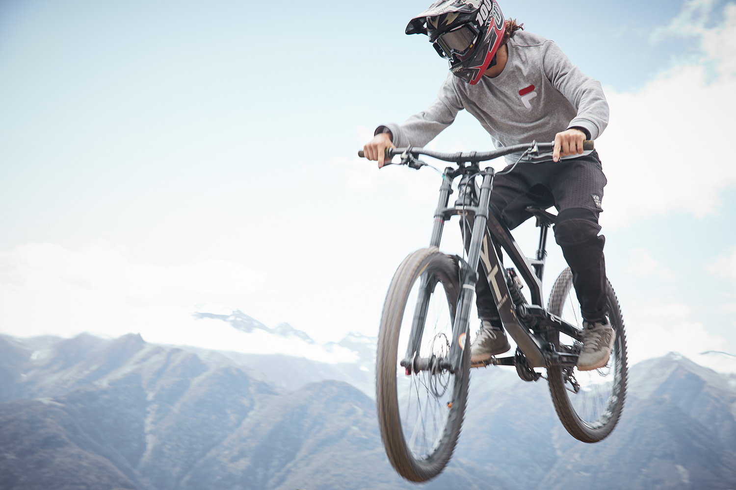Mountainbiker jumping with helmet and goggles at Serfauss-fiss-ladis