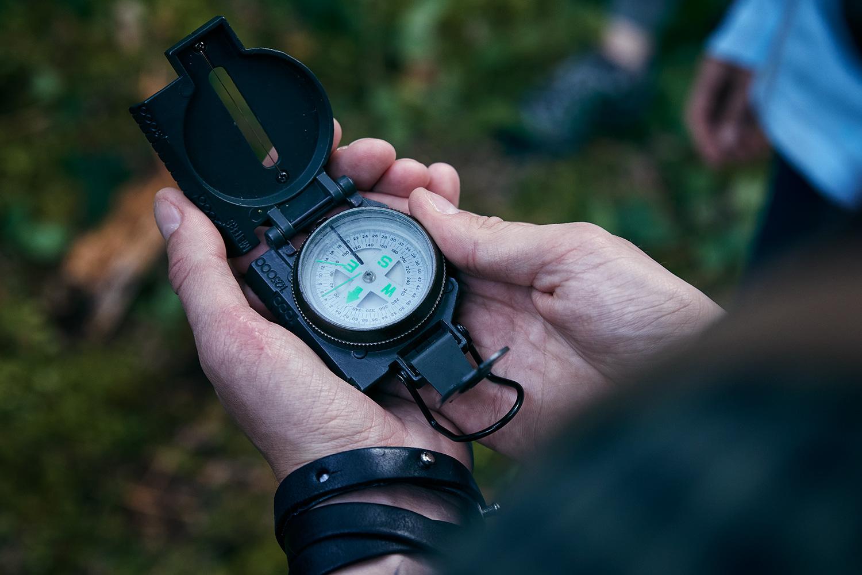 close-up of a man's hands holding a compass