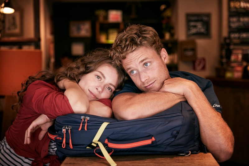 Portrait of Boy and girl leaning on their TATONKA backpack in a cafe