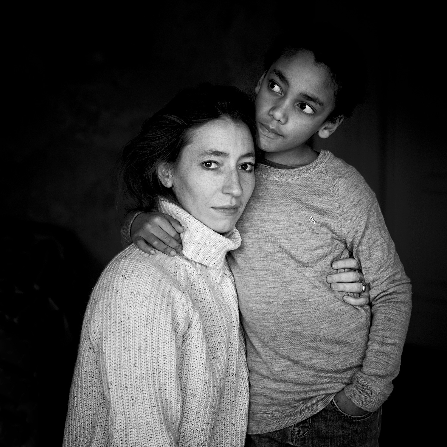 Black and white portrait of a white mother and her POC son