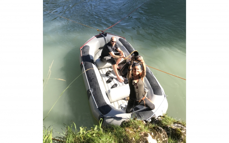 Jessica Zumpfe and her assistant navigating a boat on a shoot for Jochen Schweizer