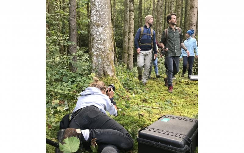 Jessica Zumpfe lying in the moss in a forest on a shoot for Jochen Schweizer