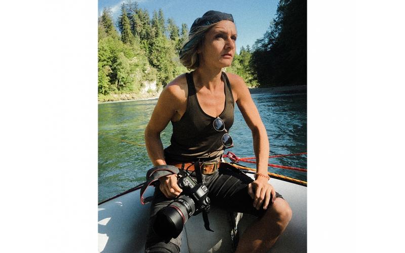 Portrait of Jessica Zumpfe sitting in a boat on a shoot for Jochen Schweizer