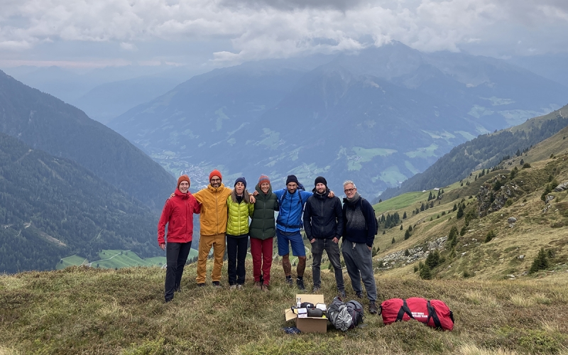 Photo Team for TATONKA Catalogue Shoot with Jessica Zumpfe on top of the mountain in the dolomites