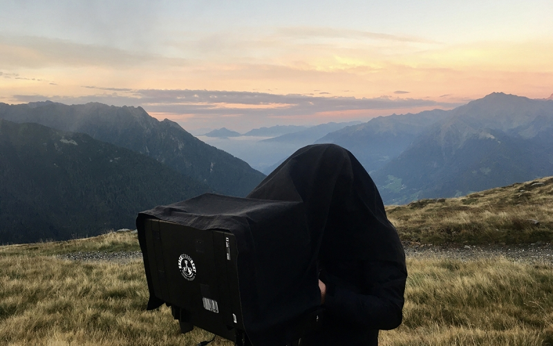 iworkcase on the top of the mountains in the dolomites on a shoot for TATONKA for Jessica Zumpfe
