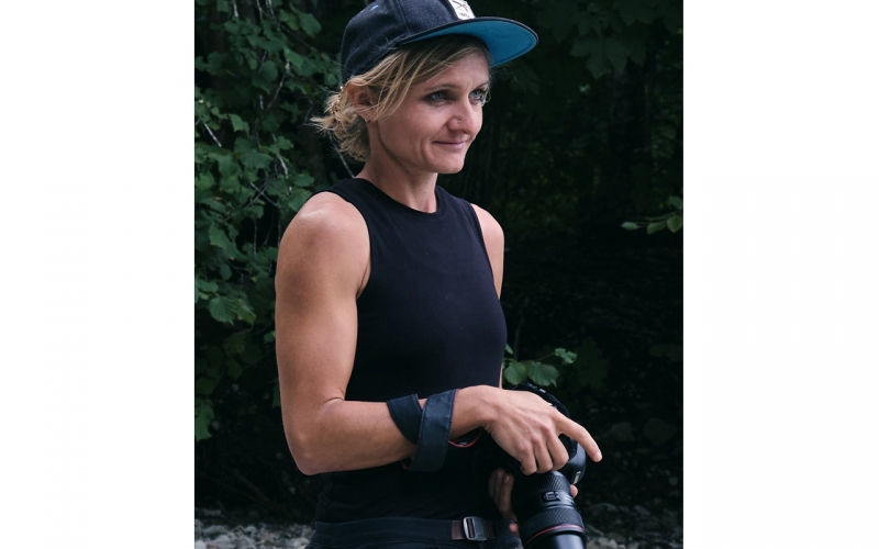 Portrait of Jessica Zumpfe Photography with Camera on a campaign shoot for Jochen Schweizer