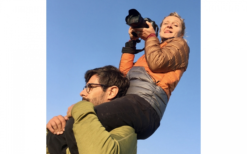 Jessica Zumpfe on the shoulders of her assistant on a catalogue shoot for TATONKA