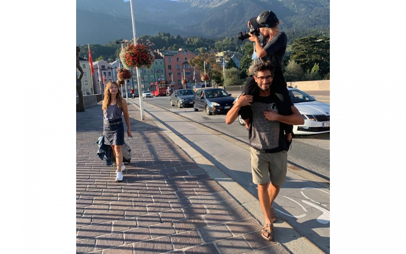 Jessica Zumpfe being carried on the shoulders of her assistant on a catalogue shoot for TATONKA
