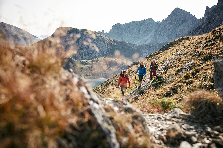 Three friends hiking in the mountains at Axamer Lizum