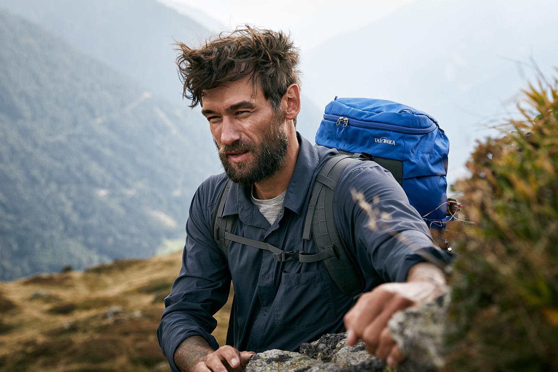 Danny scrambling across a rock ontop of the mountain