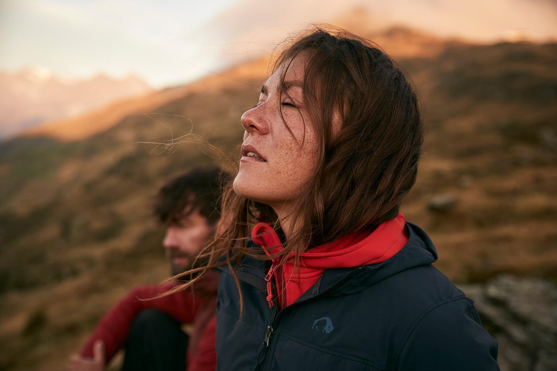 Mana enjoying the morning sun on her face ontop of the mountain at sunrise